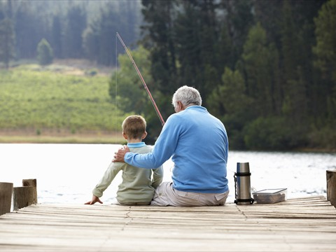 bigstock-Senior-man-fishing-with-grands-33112739