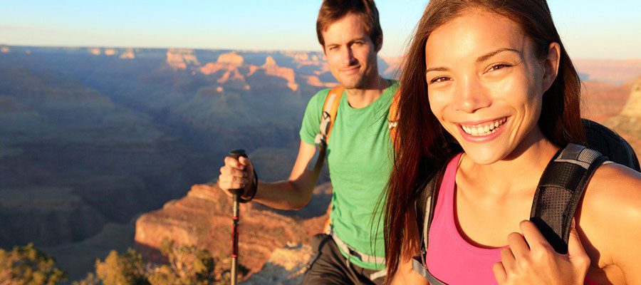 bigstock-Couple-hikers-in-Grand-Canyon--41035897